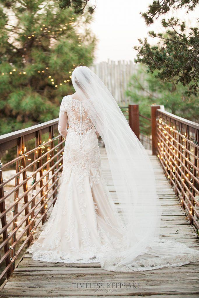 Bride posing on bridge